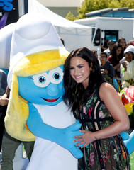 """Actor Demi Lovato, poses with the Smurfette character who she voices in the film """"Smurfs: The Lost Village"""" at it's premiere in Culver City, California"""
