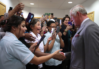 Britain's Prince Charles talks to nurses as he leaves after meeting paramedics and support staff who assisted victims of the recent attack in Westminster, at King's College Hospital in south London
