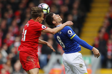 Liverpool's Lucas Leiva in action with Everton's Ross Barkley