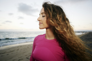 Wind blowing hair of Caucasian woman on beach