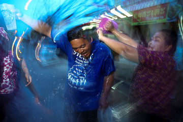 Revellers take part in a water fight at Songkran Festival celebrations in Bangkok