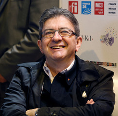 Candidate for the 2017 presidential election Jean-Luc Melenchon of the French far left Parti de Gauche reacts as he visits the 2017 Paris Book Fair