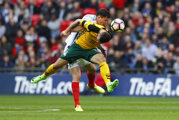 Lithuania's Nerijus Valskis in action with England's Michael Keane