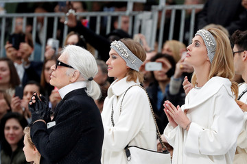 German designer Karl Lagerfeld appears at the end of his Fall/Winter 2017-2018 women's ready-to-wear collection for fashion house Chanel at the Grand Palais during Fashion Week in Paris