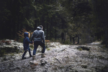 Caucasian father and daughter walking in woods