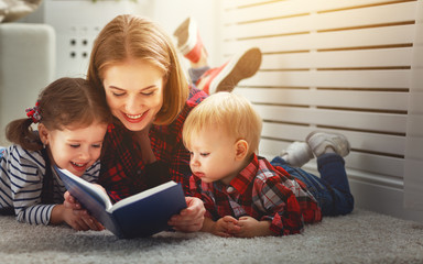 Mother reads book to children