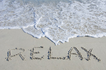 Relax Written in the Sand