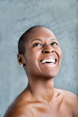 Portrait of smiling Black woman looking up