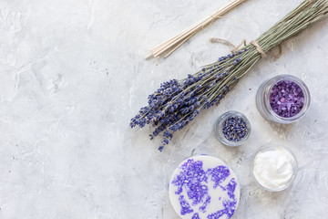 natural herb cosmetic with lavender flatlay on stone background top view mockup