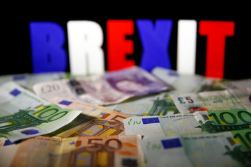 Euro and Pound banknotes are seen in front of BREXIT letters in this picture illustration