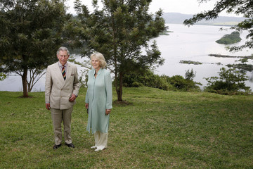 Britain's Prince Charles and his wife Camilla, Duchess of Cornwall, pose for photographers at the Nile Gardens in Jinja