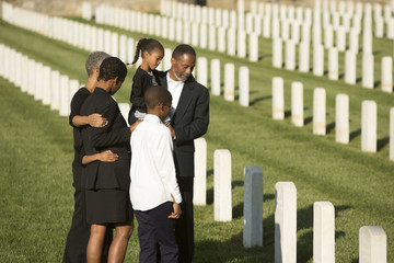 Multi-generation Black family at military cemetery