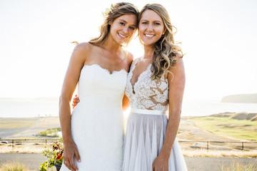Portrait of smiling Caucasian brides