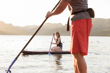 Couple on paddleboards in river