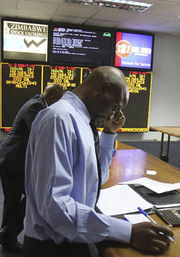 Stockbrokers trade on the floor of the Zimbabwe Stock Exchange in Harare