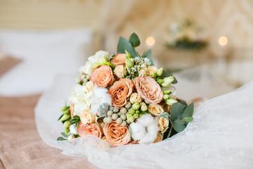 Wedding bouquet from pretty orange roses
