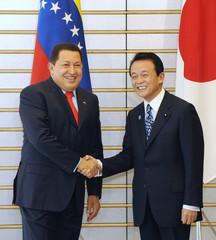 Venezuela's President Hugo Chavez shakes hands with Japanese Prime Minister Taro Aso in Tokyo
