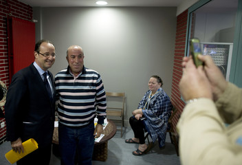 Francois Hollande, France's Socialist Party candidate for the 2012 French presidential election, visits an Emmaus charity centre in Paris