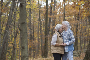 Caucasian women kissing outdoors in autumn