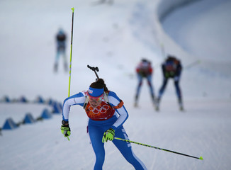 Italy's Wierer skis during mixed biathlon relay at 2014 Sochi Olympic Games