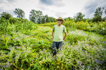 Caucasian farmer wearing cowboy hat in field