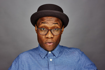 attractive young black male studio with hat serious face