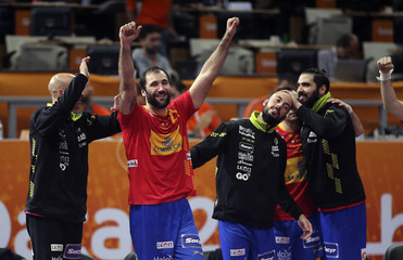 Canellas of Spain and team mates celebrate after their round of 16 match against Tunisia in the 24th men's handball World Championship in Doha