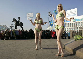 PETA members hold protest to urge Kazakhs to go vegetarian near the Independence monument in Almaty
