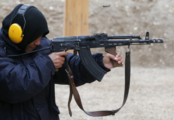A female ANP trainee fires her weapon at the shooting range at a training centre near army camp Marmal in Mazar-e-Sharif