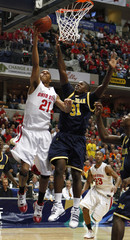 Ohio State's Turner scores on Michigan's Lucas-Perry during their Big Ten Tournament game in Indianapolis