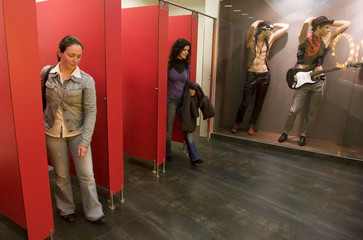 Women leave their cubicles in a public lavatory decorated with male mannequins in Sao Joao da Madeira shopping centre in northern Portugal