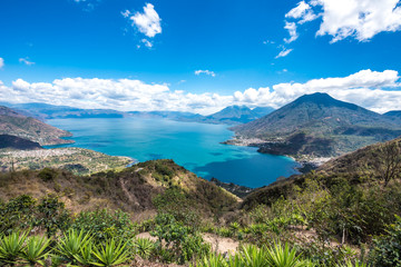 Panorama view to the lake Atitlan with volcanos - small villages San Pedro, San Marcos, San Juan and Panajachel at lake Atitlan in the highland of Guatemala