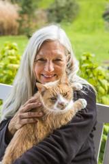 Portrait of smiling Caucasian woman holding cat