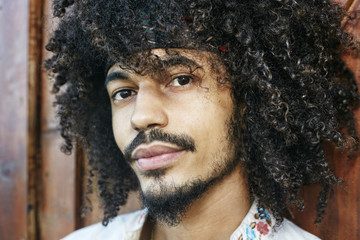 Portrait of serious Mixed Race man
