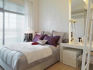 Elegant bed in modern bedroom