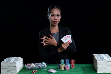Female clamp red dices between her fingers and holding Hearts Suit Straight Flush
