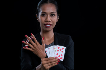 The female banker clamp red dices between her fingers and holding Hearts Suit Straight Flush