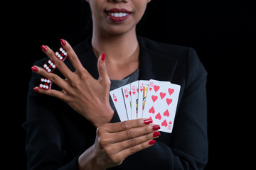 close up at hand clamp red dices between fingers and holding Hearts Suit Straight Flush