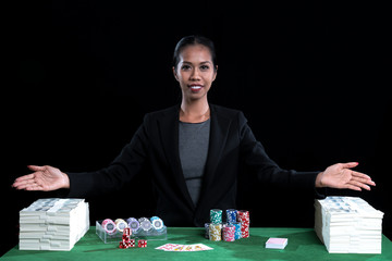 The pretty girl with stack of banknote and chips in casino