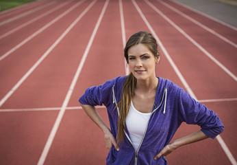 Caucasian woman posing on running track