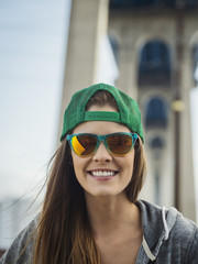 Smiling Caucasian woman posing under overpass