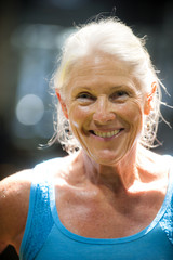 Portrait of smiling older woman sweating,