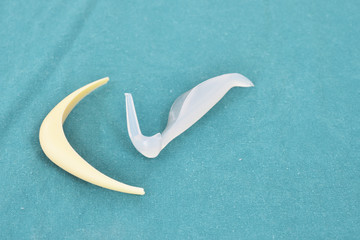 silicone nose implant and silicone chin implant on surgical coat.