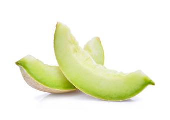 slice of green cantaloupe melon isolated on white background