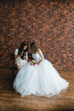 Photographer shows the bride had just taken photos