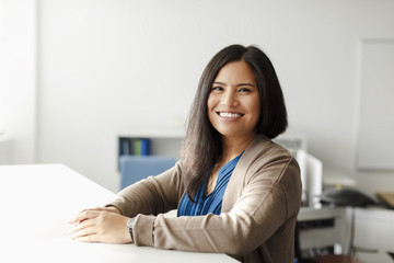 Smiling Pacific Islander woman in office