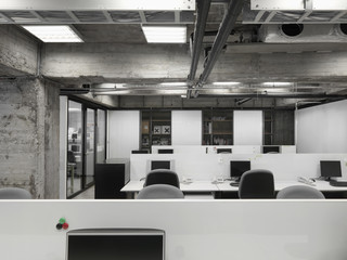Modern industrial office with rows of computers