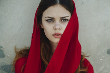 Serious Caucasian woman wearing red headscarf