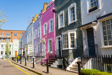 Pastel colored restored Victorian British houses in an elegant mews in Chelsea, London, UK