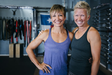 Smiling Caucasian women posing in gymnasium